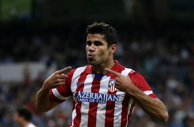 Atletico Madrid's Diego Costa celebrates his goal during their Spanish first division soccer match against Real Madrid at Santiago Bernabeu stadium in Madrid September 28, 2013. REUTERS/Juan Medina (SPAIN - Tags: SPORT SOCCER)