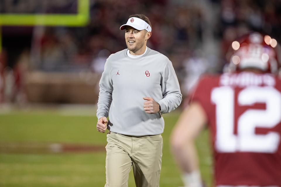 Oklahoma Sooners head coach Lincoln Riley smiles as he watches warmups during the Big 12 college football game between the Oklahoma Sooners and the TCU Horned Frogs on November 23, 2019, at Gaylord Family Oklahoma Memorial Stadium in Norman, OK.