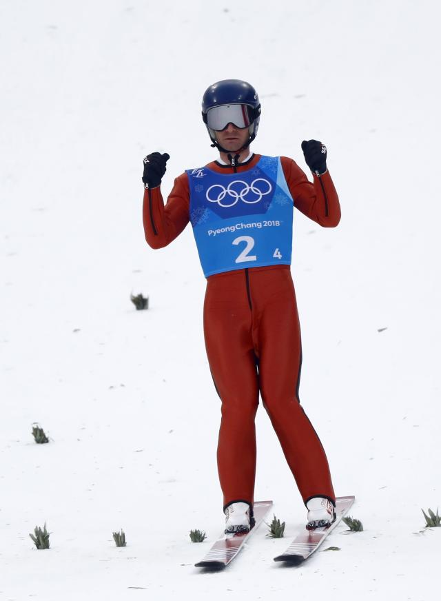 Nordic Combined Events - Pyeongchang 2018 Winter Olympics - Men's Team Gundersen LH Competition - Alpensia Ski Jumping Centre - Pyeongchang, South Korea - February 22, 2018 - Bryan Fletcher of the U.S. reacts. REUTERS/Kai Pfaffenbach