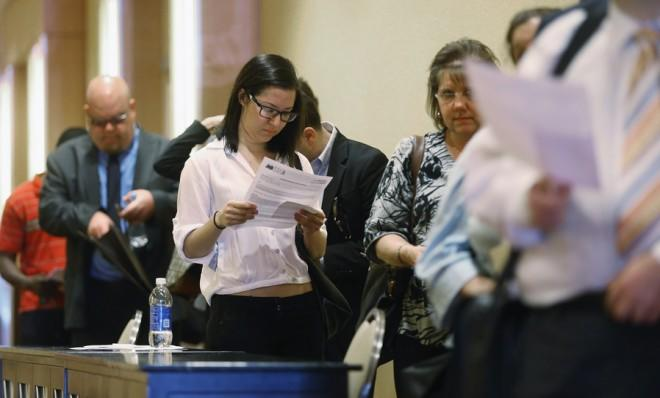 Job seekers wait in line to attend a Long Island job fair on May 2 in New York.