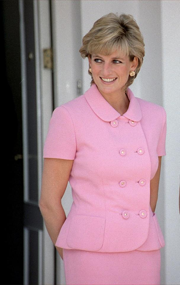 "<p>Pastel pink is a favorite color among royals (just <a href=""https://www.cosmopolitan.com/entertainment/celebs/g14000558/meghan-markle-kate-middleton-style-photos/"" target=""_blank"">ask Kate Middleton</a>). Diana wore this skirt-suit, with button detailing down the front while in Argentina in November 1995.</p>"