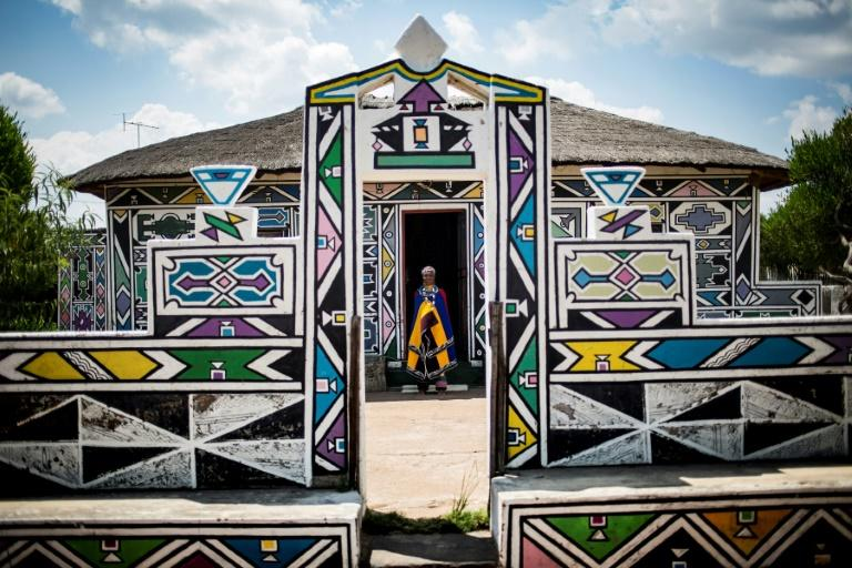 South African artist Esther Mahlangu, 81, whose colourful geometric works are exhibited around the world, stands outside her home in Mpumalanga