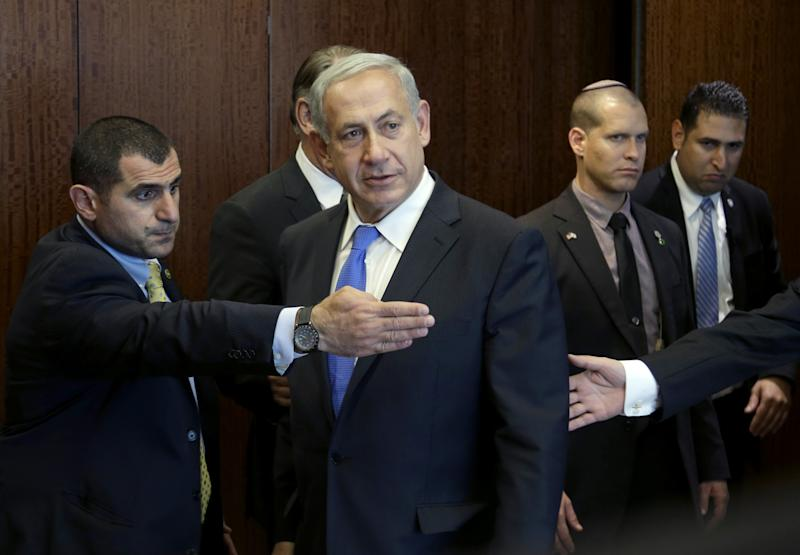 Israeli Prime Minister Benjamin Netanyahu, center, arrives for a meeting with United Nations Secretary-General Ban Ki-moon during the 68th session of the General Assembly at U.N. headquarters, Tuesday, Oct. 1, 2013. (AP Photo/Seth Wenig)