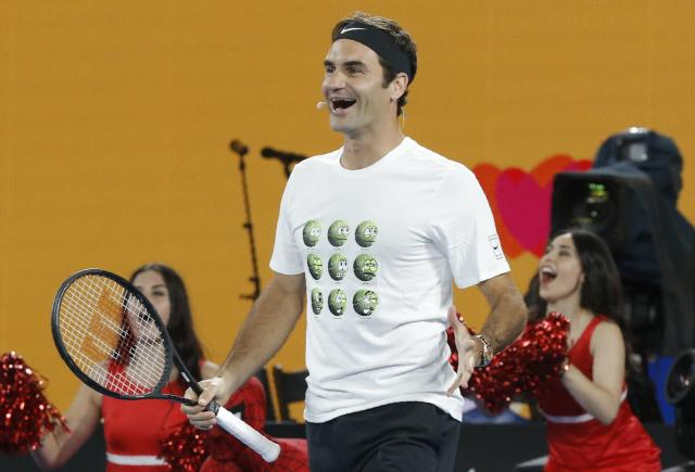 Tennis - Australian Open - Kids Tennis Day - Rod Laver Arena, Melbourne, Australia, January 13, 2018. Roger Federer of Switzerland reacts during Kids Tennis Day before the Australian Open tennis tournament. REUTERS/Thomas Peter