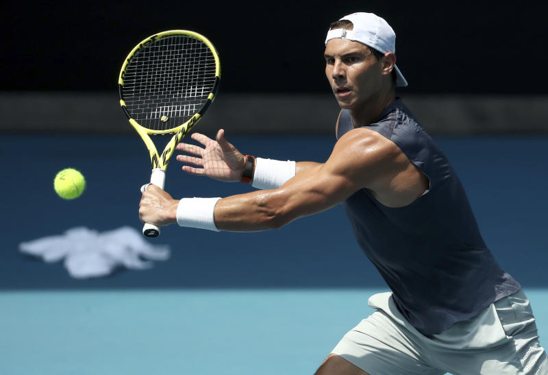 Spain's Rafael Nadal makes backhand return during a practice session ahead of the Australian Open tennis championship in Melbourne, Australia, Sunday, Jan. 19, 2020. (AP Photo/Dita Alangkara)