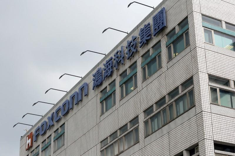 The logo of Foxconn, the trading name of Hon Hai Precision Industry, is seen on top of the company's headquarters in New Taipei City