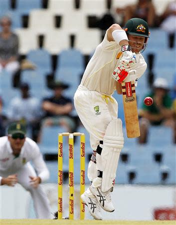 Australia's David Warner plays a shot during the third day of their cricket test match against South Africa in Centurion February 14, 2014. REUTERS/Siphiwe Sibeko