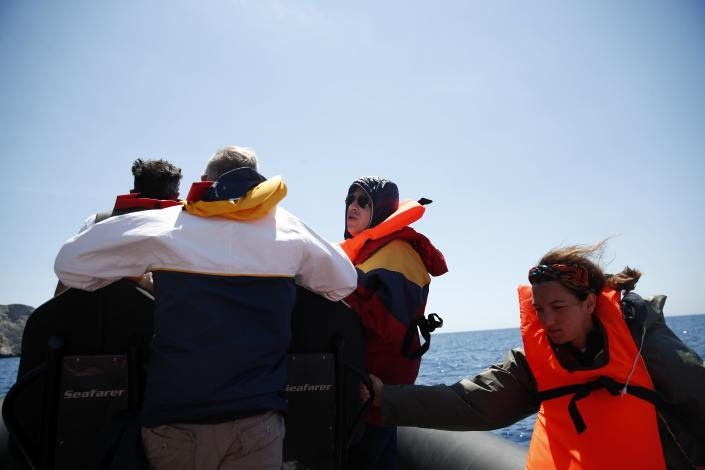 In this Monday, May 25, 2020 photo, medical staff in a speedboat crosses the Aegean Sea, Greece. Using dinghies, a GPS, and a portable refrigerator, state doctors have launched a COVID-19 testing drive on islands in the Aegean Sea ahead of the holiday season. The first round of testing was completed after trips to the islands of Milos, Kimolos, Folegandros, and Sikinos. (AP Photo/Thanassis Stavrakis)