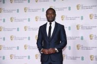 Actor David Oyelowo poses for photographers upon arrival at the Bafta Film Awards, in central London, Sunday, April 11 2021. (AP Photo/Alberto Pezzali)