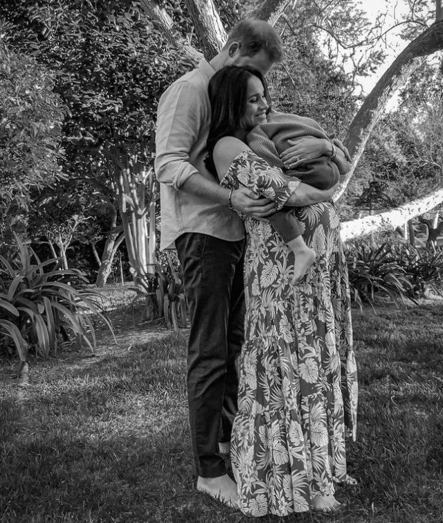 Harry and pregnant Meghan holding Archie