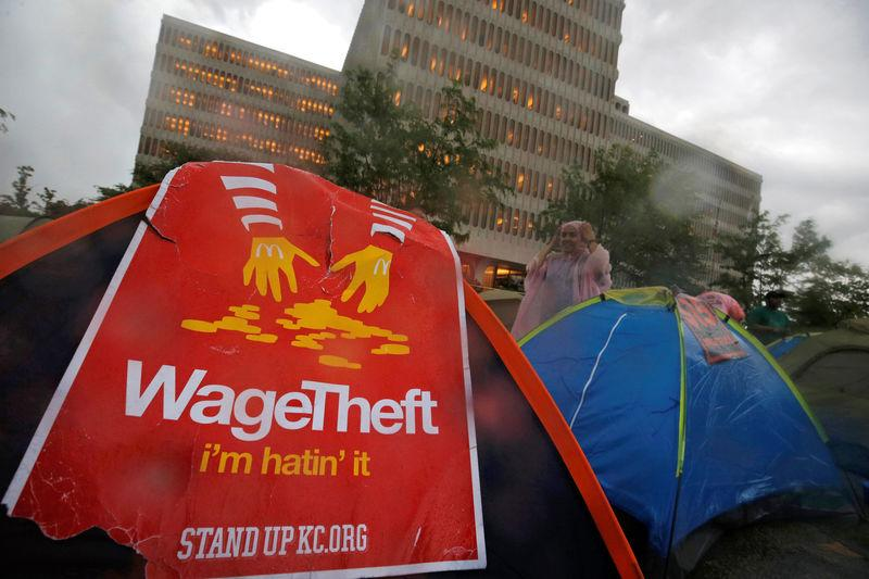 Protesters set up tents on the street as they demonstrate outside the McDonald's headquarters calling for higher wages and improved working conditions in the Chicago suburb of Oak Brook