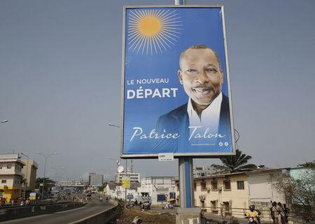 A billboard campaigning for presidential candidate, Patrice Talon, is seen along a road in the Akpakpa district in Cotonou, Benin, March 4, 2016. REUTERS/Akintunde Akinleye