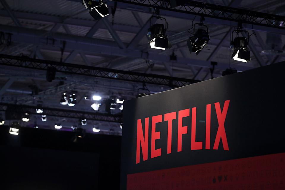 A Netflix Inc. logo sits on the online television streaming company's exhibition area at the Gamescom gaming industry event in Cologne, Germany, on Tuesday, Aug. 20, 2019. Gamescom is the world's largest gaming convention and runs from August 20 to 24. Photographer: Krisztian Bocsi/Bloomberg via Getty Images