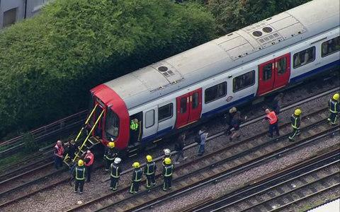 Passengers are led away from a District Line Tube at Parsons Green - Credit: AP