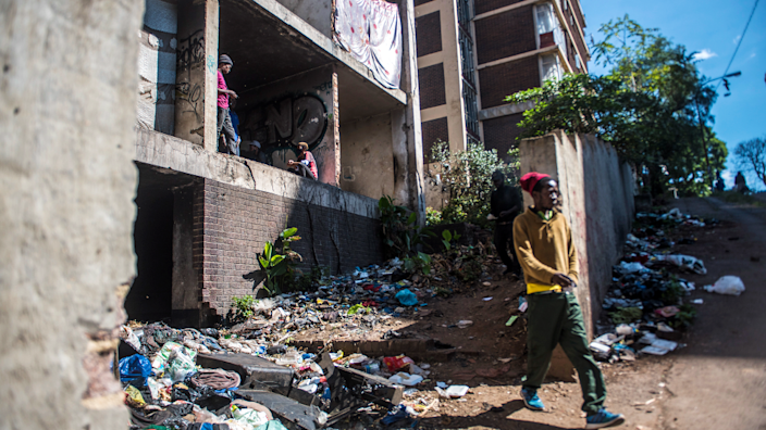 An unidentified man is seen leaving the San Jose the derelict San Jose building in Johannesburg, South Africa