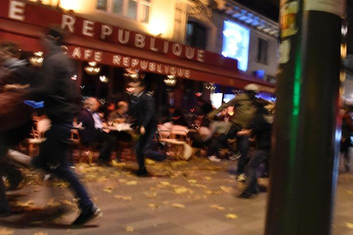 People run after hearing what is believed to be explosions or gun shots near Place de la Republique square in Paris on November 13, 2015 (AFP Photo/Dominique Faget)