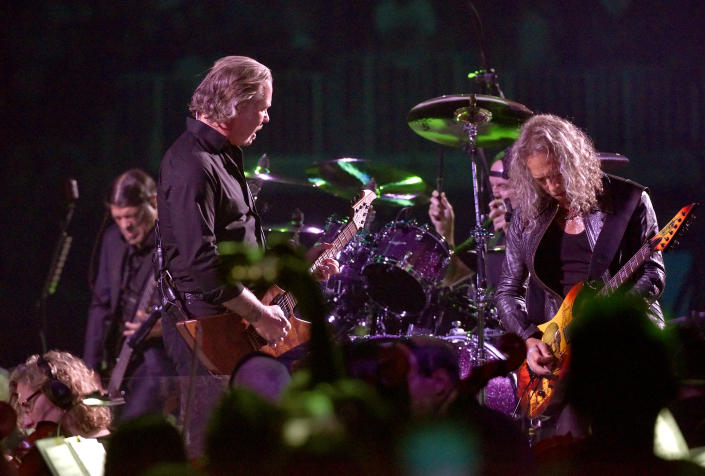"""Robert Trujillo, James Hetfield, Lars Ulrich, and Kirk Hammett of Metallica perform during the """"S&M2"""" concerts at the opening night at Chase Center on September 06, 2019 in San Francisco, California. (Photo by Tim Mosenfelder/Getty Images)"""