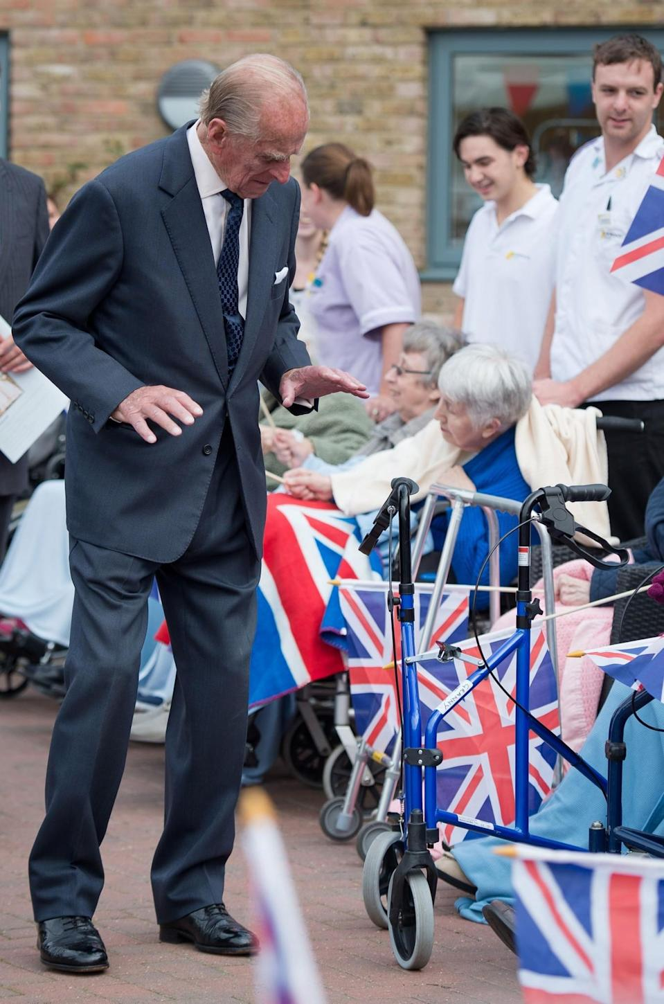 <p>The Duke of Edinburgh reaction after seeing a rollator walking frame while meeting residents of the St Michael's Care Complex in Aylsham, Norfolk, during his official visit to the centre that provides care for the elderly. (Photo credit: Leon Neal   PA Archive/PA Images) </p>