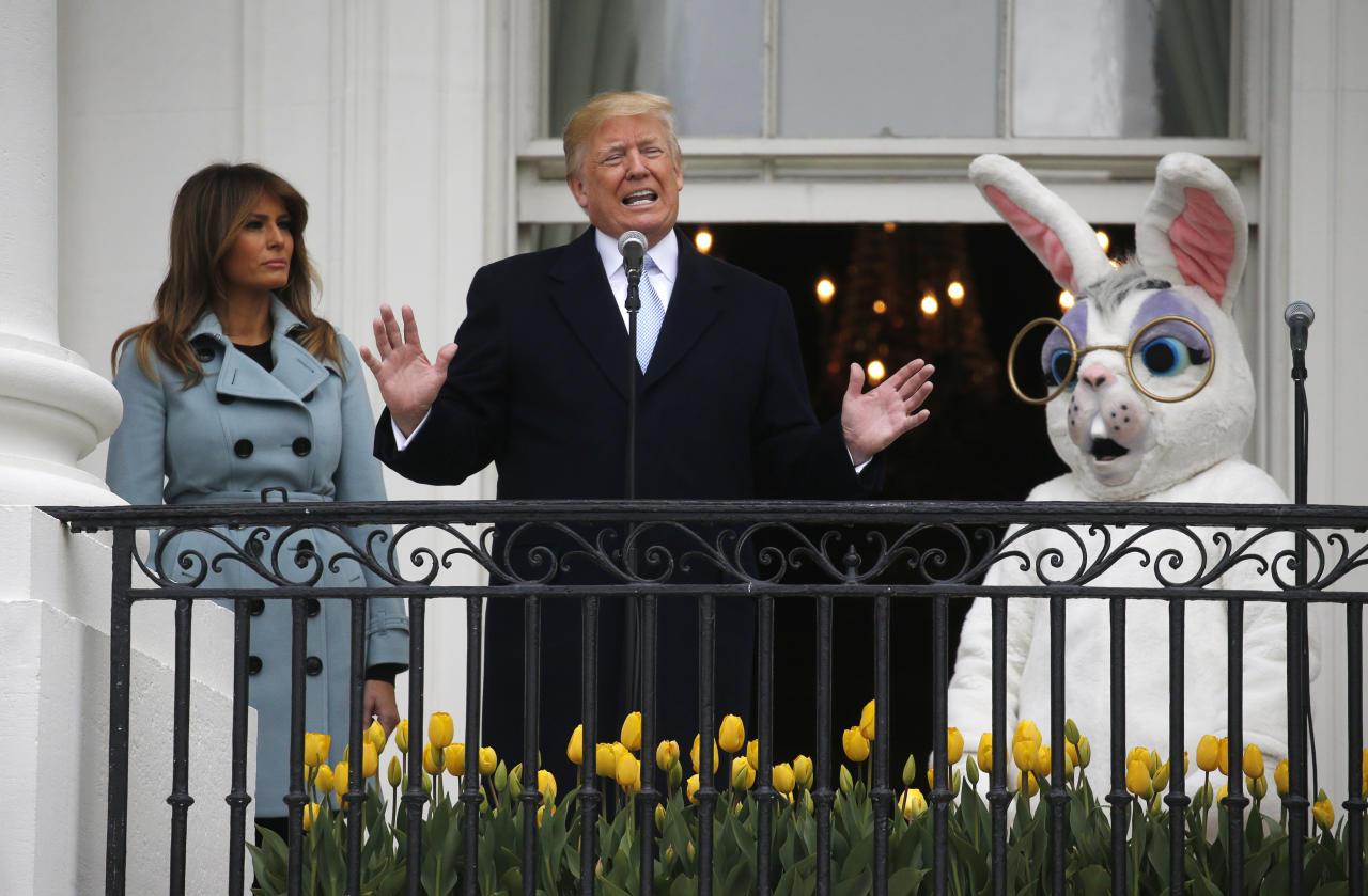 <p>U.S. President Donald Trump speaks to the crowd from the South Portico of the White House with first lady Melania Trump and the Easter Bunny at his sides as the annual White House Easter Egg Roll is held on the South Lawn of the White House in Washington, U.S., April 2, 2018. (Photo: Leah Millis/Reuters) </p>