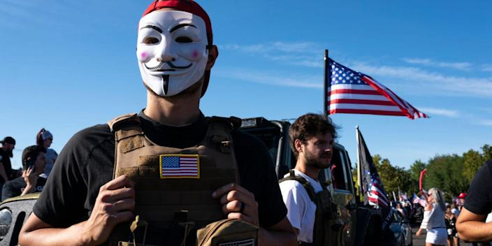 """A man who identified himself only as Jonathan wears a Guy Fawkes mask during a rally in support of President Trump on August 29, 2020 in Clackamas, Oregon. <p class=""""copyright"""">Nathan Howard/Getty Images</p>"""