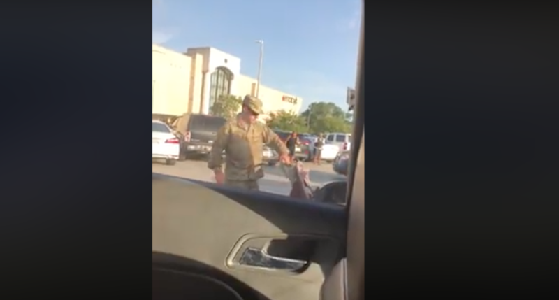 A Fort Stewart soldier is in military police custody after an outburst in a mall parking lot was captured on camera and shared on Facebook. (Photo: Facebook)