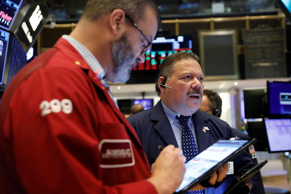 Traders work on the floor of the New York Stock Exchange shortly after the opening bell in New York City, U.S., November 21, 2019.  REUTERS/Lucas Jackson