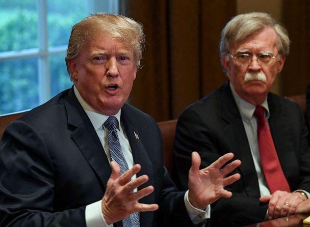 PHOTO: In this April 9, 2018, file photo, President Donald Trump flanked by national security advisor John Bolton, speaks to the media as he meets with senior military leadership in the Cabinet Room of the White House in Washington, D.C. (Ricky Carioti/The Washington Post via Getty Images, FILE)