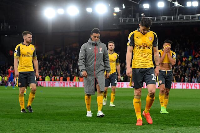 Granit Xhaka of Arsenal looks dejected in defeat with team mates after the Premier League match between Crystal Palace and Arsenal at Selhurst Park