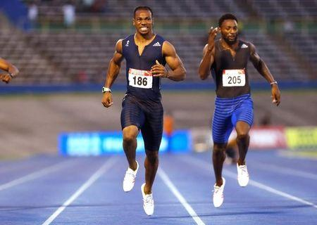 Athletics - JAAA National Senior Championships - Men's 200m final - National Stadium Kingston, Jamaica - June 25, 2017 Jamaica's Yohan Blake (L) and Rasheed Dwyer in action. REUTERS/Lucy Nicholson