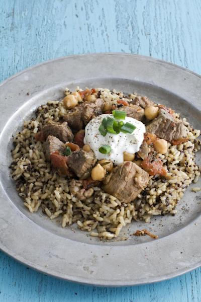 In this image taken on March 18, 2013, rosemary lamb tagine with chickpeas and tomatoes is shown served on a plate in Concord, N.H. (AP Photo/Matthew Mead)