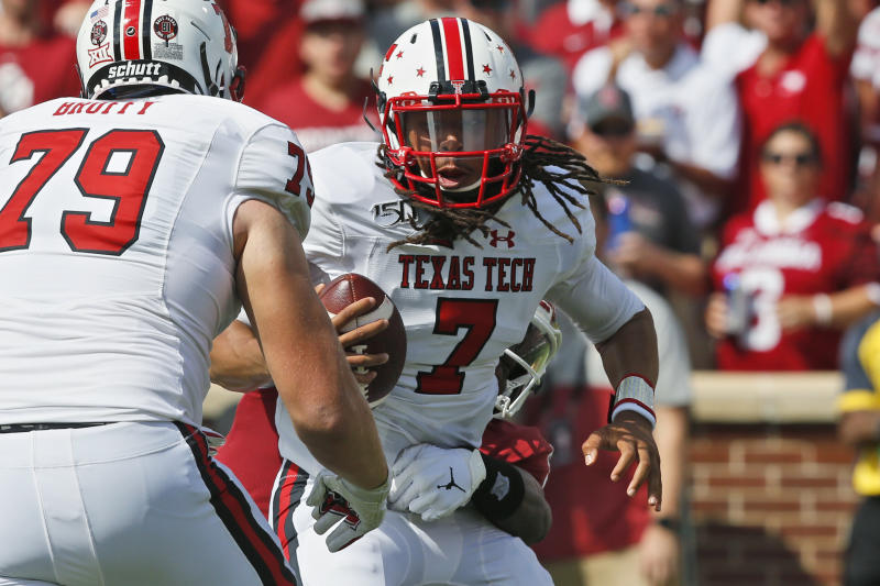 Texas Tech quarterback Jett Duffey (7) is brought down from behind by Oklahoma linebacker Kenneth Murray (9) in the first quarter of an NCAA college football game in Norman, Okla., Saturday, Sept. 28, 2019. (AP Photo/Sue Ogrocki)