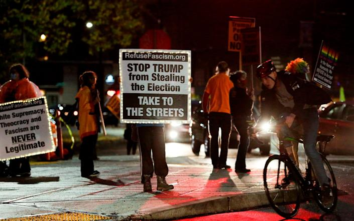 Anti-Trump protesters in Seattle, Washington, which is expected to be called for the Democrats - GETTY IMAGES