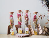 <p>If you don't like the idea of carrying a bouquet around. How about carrying a glass tube of dried flowers? Available at The Bloom Inc. (Photo: @thebloomincsg/Instagram) </p>