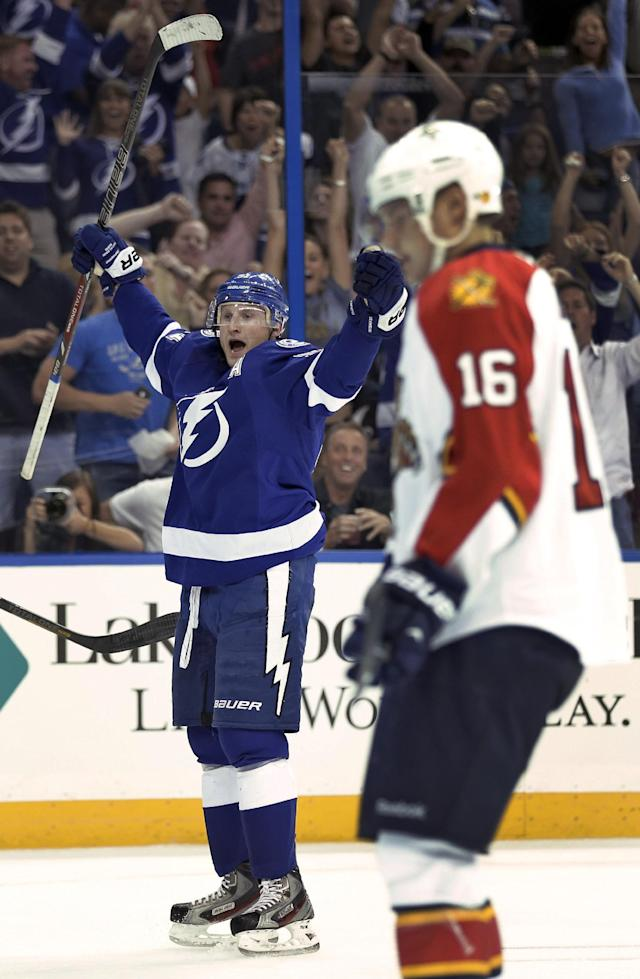Tampa Bay Lightning center Steven Stamkos (91) celebrates in front of Florida Panthers center Aleksander Barkov (16), of Finland, after scoring during the second period of an NHL hockey game Thursday, Oct. 10, 2013, in Tampa, Fla. (AP Photo/Chris O'Meara)