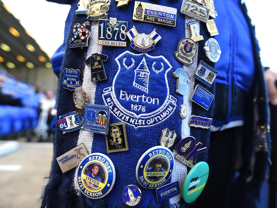 A fan displays their Everton pin badge collection (Getty Images)