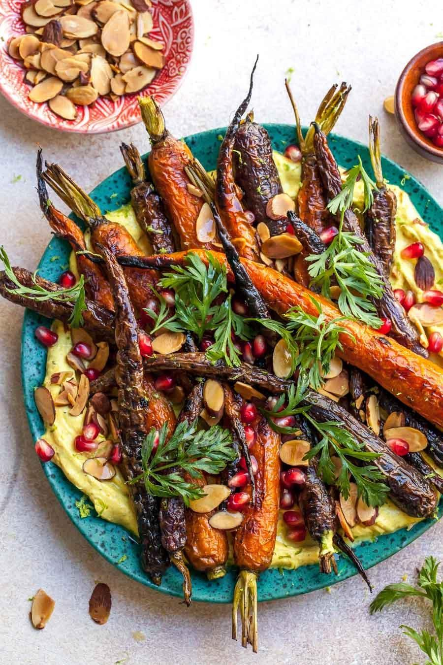 "<p>This simple side dish requires only five ingredients and is vegetarian. While the original recipe serves six, you can cut the recipe in thirds to serve two. </p> <p><strong>Get the recipe:</strong> <a href=""http://dishingouthealth.com/roasted-carrots-with-curried-yogurt-5-ingredients/"" class=""link rapid-noclick-resp"" rel=""nofollow noopener"" target=""_blank"" data-ylk=""slk:roasted carrots with curried yogurt"">roasted carrots with curried yogurt</a></p>"