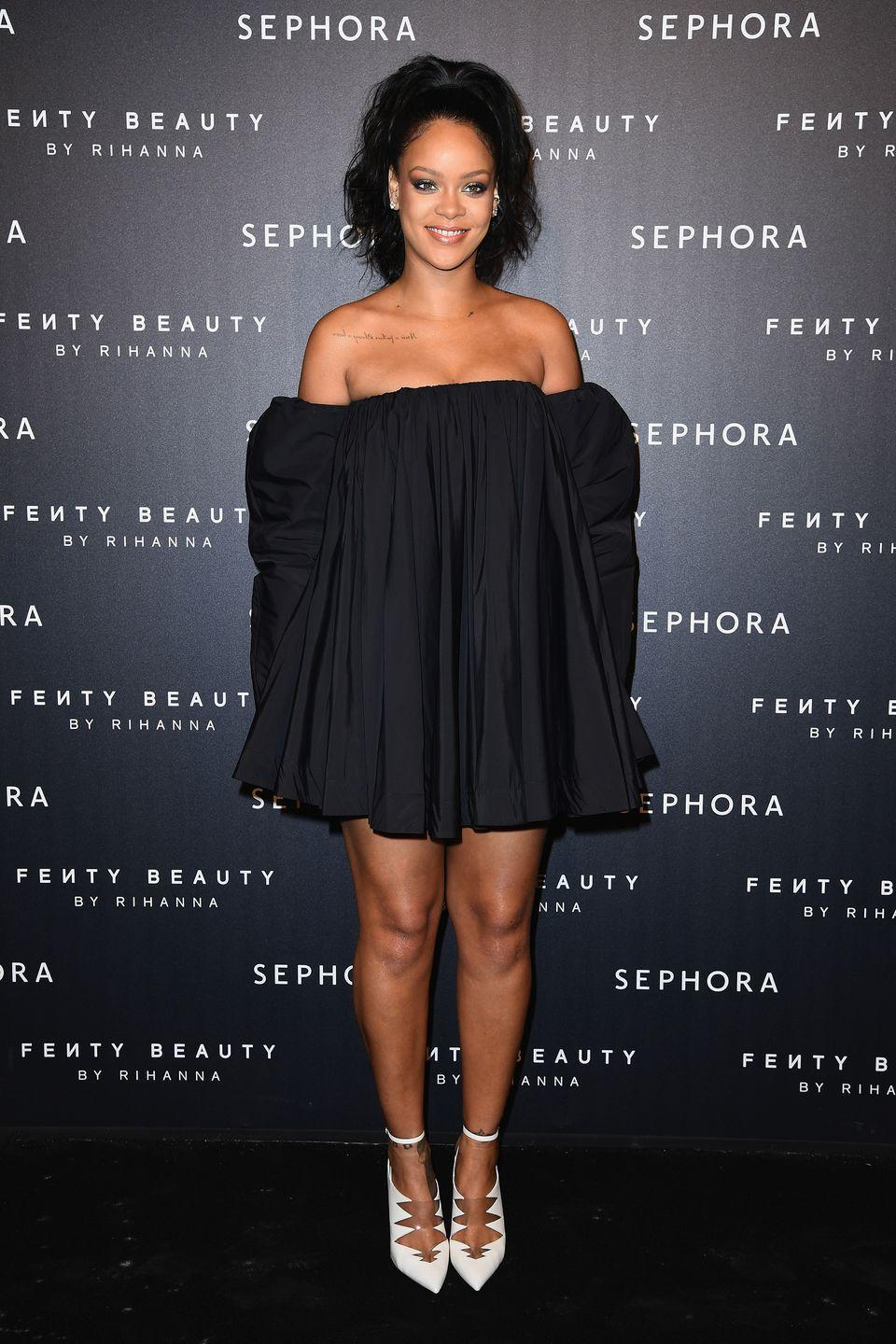 <p>In an off-the-shoulder Calvin Klein dress and white pointed-toe shoes at the Fenty Beauty launch in Paris.</p>