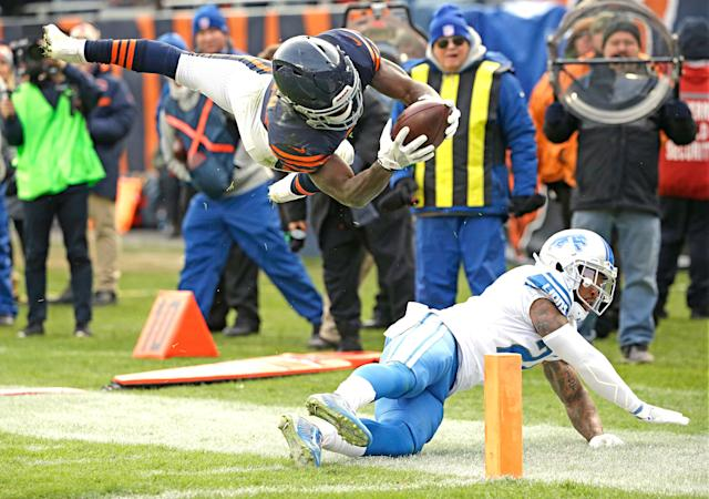 <p>Chicago Bears running back Tarik Cohen leaps over Detroit Lions free safety Glover Quin into the end zone for a touchdown during the second half of an NFL football game, Sunday, Nov. 19, 2017, in Chicago. (AP Photo/Nam Y. Huh) </p>