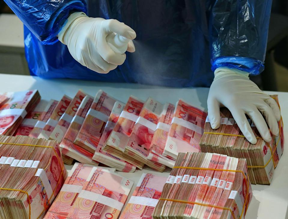 Banks in China began disinfecting and isolating used banknotes last month as part of efforts to stem the spread of coronavirus. (Feature China/Barcroft Media via Getty Images)