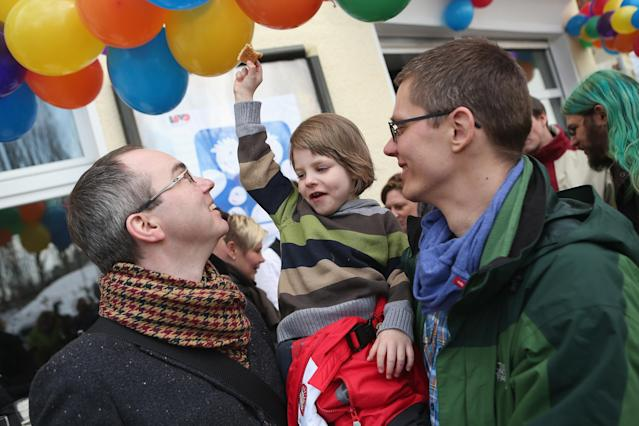 BERLIN, GERMANY - MARCH 15: Gay couple Kai (L) and Michael Korok and their daughter Jana, 4, attend the opening of Germany's first gay parent counseling center on March 15, 2013 in Berlin, Germany. The Regenbogenfamilien Zentrum (Rainbow Families Center) will provide counseling and other services to families with gay, lesbian and transgender parents. Gay marriage is legal in Germany though gay couples are not entitled to the same full legal rights as heterosexual couples, and the issue of child adoption by gay couples remains legally somewhat complicated. (Photo by Sean Gallup/Getty Images)