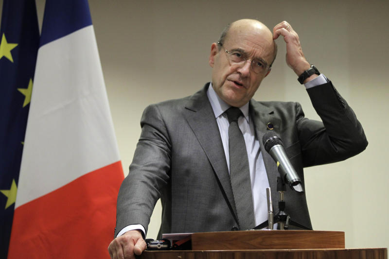 French Foreign Minister Alain Juppe speaks to the media during a press conference after the Somalia Conference in London, Thursday, Feb. 23, 2012. (AP Photo/Sang Tan)