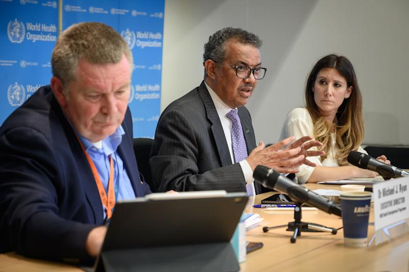 "World Health Organization (WHO) Director-General Tedros Adhanom Ghebreyesus (C) speaks past WHO Health Emergencies Programme Director Michael Ryan (L) and WHO Technical Lead Maria Van Kerkhove during a daily press briefing on COVID-19 virus at the WHO headquaters in Geneva on March 9, 2020. - The World Health Organization said on March 9, 2020 that more than 70 percent of those infected with the new coronavirus in China have recovered, adding that the country was ""bringing its epidemic under control"". (Photo by Fabrice COFFRINI / AFP) (Photo by FABRICE COFFRINI/AFP via Getty Images)"