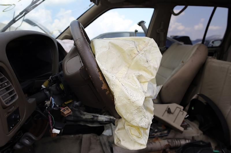 A deployed airbag is seen inside a Nissan vehicle at a salvage yard in Medley, Florida (AFP Photo/Joe Raedle)