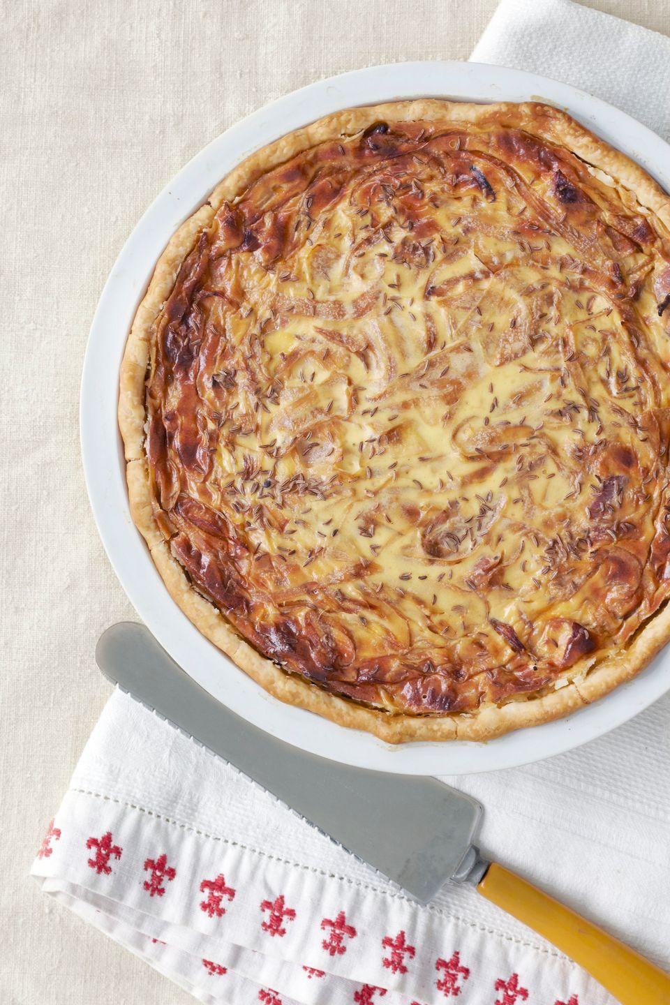 "<p>Sautéed onions, bacon, and eggs are baked inside a delicate crust.</p><p><strong><a href=""https://www.countryliving.com/food-drinks/recipes/a3523/onion-pie-recipe-clv1210/?click=recipe_sr"" rel=""nofollow noopener"" target=""_blank"" data-ylk=""slk:Get the recipe"" class=""link rapid-noclick-resp"">Get the recipe</a>.</strong></p>"