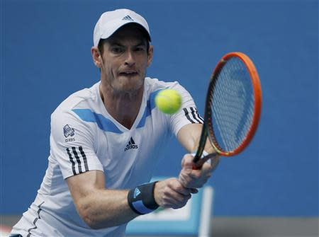 Andy Murray of Britain hits a return to Feliciano Lopez of Spain during their men's singles match at the Australian Open 2014 tennis tournament in Melbourne
