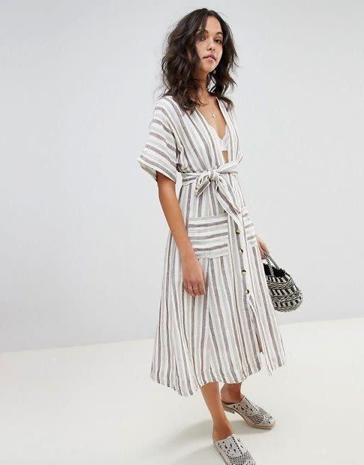 "<strong><a href=""https://us.asos.com/free-people/free-people-monday-midi-dress/prd/9471149"" rel=""nofollow noopener"" target=""_blank"" data-ylk=""slk:Free People Monday midi dress"" class=""link rapid-noclick-resp"">Free People Monday midi dress</a>, $100</strong>"