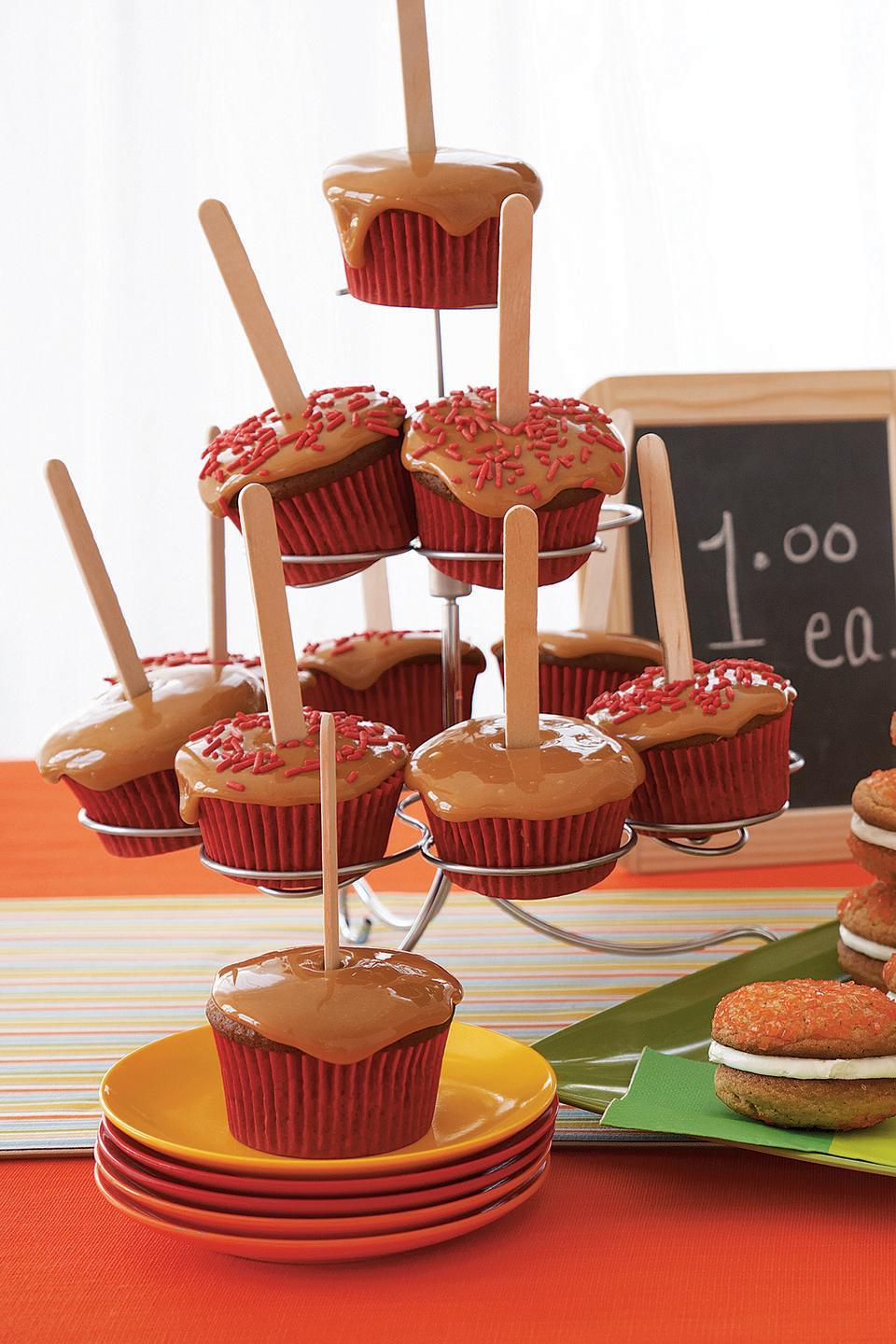 """<p>As if caramel apples could get any better. These cupcakes are super moist and will satisfy those who have the ultimate sweet tooth.</p><p><em><a href=""""https://www.womansday.com/food-recipes/food-drinks/recipes/a10744/candy-apple-cupcakes-122126/"""" rel=""""nofollow noopener"""" target=""""_blank"""" data-ylk=""""slk:Get the Candy Apple Cupcakes recipe."""" class=""""link rapid-noclick-resp"""">Get the Candy Apple Cupcakes recipe. </a></em></p>"""