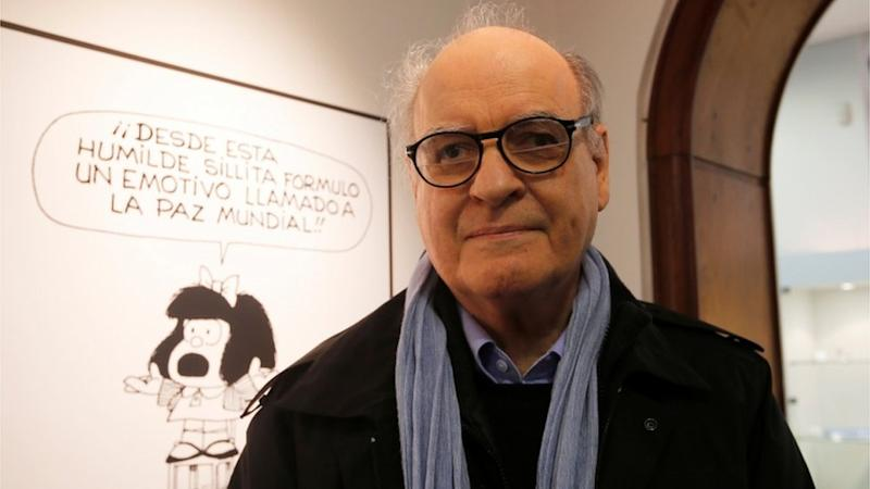 Argentine cartoonist Joaquin Lavado, also known by his pen name Quino, poses in front of an image of his most famous comic character Mafalda during the opening ceremony of the exhibition of his works at the Museo del Humor in Buenos Aires June 14, 2014