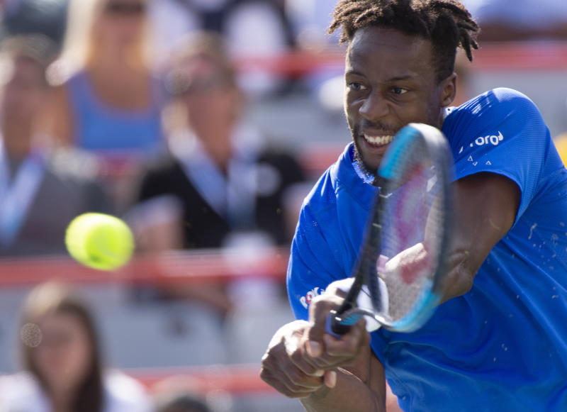 Gael Monfils, of France, returns to Roberto Bautista Agut, of Spain, during the Rogers Cup men's tennis tournament Saturday Aug. 10, 2019, in Montreal.(Paul Chiasson/The Canadian Press via AP)