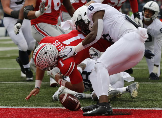 Penn State linebacker Cam Brown, right, causes Ohio State quarterback Justin Fields to fumble the ball before crossing the goal line during the first half of an NCAA college football game Saturday, Nov. 23, 2019, in Columbus, Ohio. Penn State recovered the ball for a touchback. (AP Photo/Jay LaPrete)